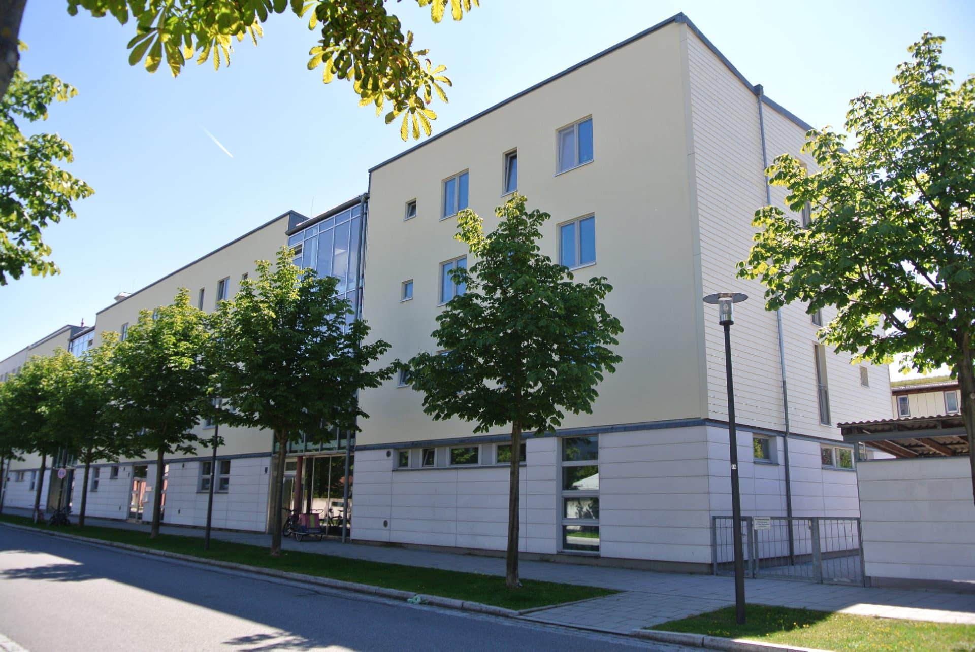 Südansicht des NEST MFH R1 mit Kita in München im Passivhausstandard.